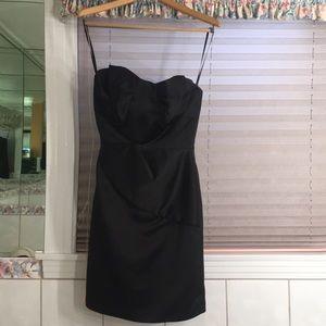 1980s sleek black cocktail dress